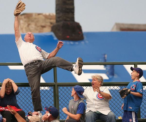 wrigley field bleachers home run catch