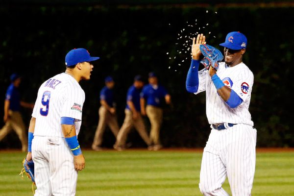 javier baez throws seeds at jorge soler